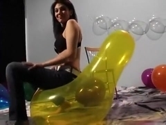 Nice sitting to pop yellow balloon