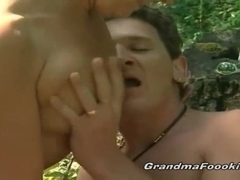 Slutty granny rides cock in nature
