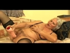 Granny Toys Her Rock Hard Muff Then Receives Fucked