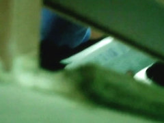 Bathroom spy cam video of Asian girl reading while pissing