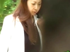 Oriental businesswoman gets very surprised when some guy grabs her clothes