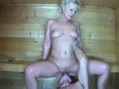Blonde granny fucks young guy in the sauna