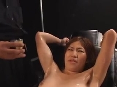 Tied up oiled Asian slut on a chair gets tortured