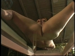Concupiscent youthful hottie fingers her constricted cunt on a coffee table