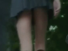 Seriously hot girl in fishnet knee highs in this upskirt attempt