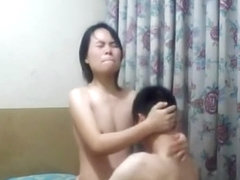Asian girl rides her man like crazy