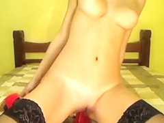 Red vibrator up her taut fuck hole