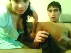 Cute hottie jerks off her boyfrend's weenie in front of webcamera