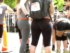 Sports girls in tight pants run cross on the street