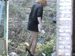 Milf losing off hose and panty and pissing outdoor