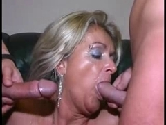 Double penetration of a sexy MILF babe who loves cock