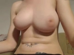 Girl teases her dangling tits