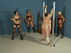 Three cruel mistresses whipping a fat slave