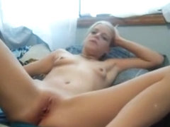 Sexy young girl masturbating on her bed