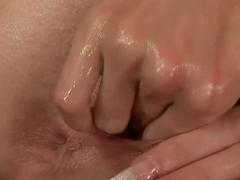 Liz oiles her big ass and starts masturbating hard