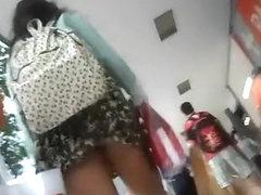 Chubby girl in short dress upskirted