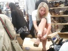 Blonde girl upskirtvoyeured in the shoe store.