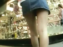 Public up skirt blonde chick shows off her juicy ass