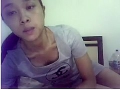 Chinese Slut plays while husband is in next room