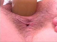 Excited wench riding sex tool like a dong at gym