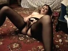 Beauty satisfying herself with a sex-toy