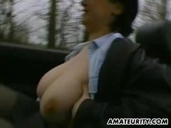 Busty amateur Milf toys and masturbates in a car