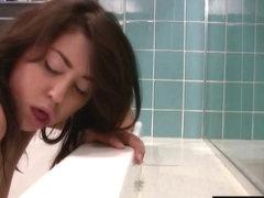 Cute Brunette in bathtub has orgasm