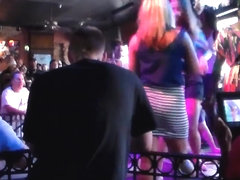Sexy blonde shaking her big ass at the club