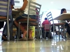 Pretty mexican girl shoeplaying in the mall