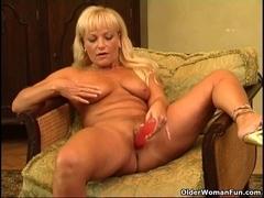 Sexy aged woman with curvy body masturbates