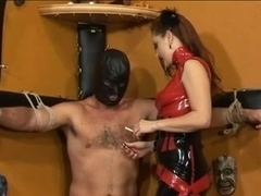 Hawt femdom-goddess in red costume burns thrall with smokin' cigarette in dungeon