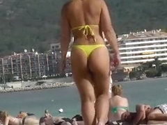 Sexy ass woman in yellow thong bikini