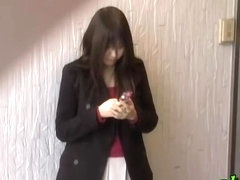 Feisty young Japanese slut holding her phone during sharking adventure