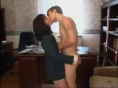 Russian office lady has dirty sex with younger worker
