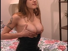 Tattooed gal in taut dark costume rubs her love muffins in the mirror at home