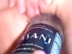fucking her bald pussy with bottle