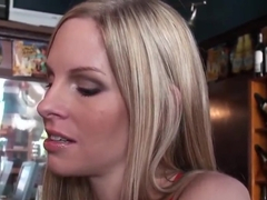 A blonde in a bar is flirted with big time