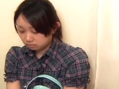 Busty Japanese girl got her slit wet on a pussy exam