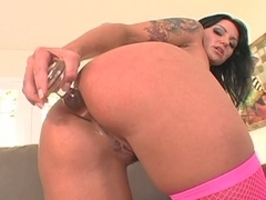Slut in pink stockings gets cum all over her face