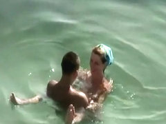Small tits and puffy nipples nudist fucking in water