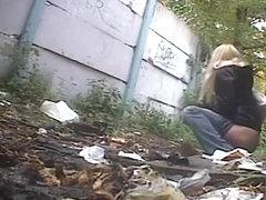 Blonde woman pees twice