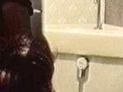 Toilet cam records amateur rubbing pussy through panty