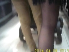 Shopper in black pantyhose and shorts