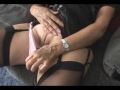 Mature tramp rubbing her wet cunny