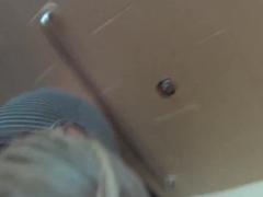 MILF fucks in public bathroom stall
