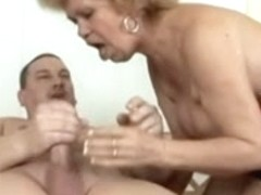 Busty blonde mature on her knees sucking big cock