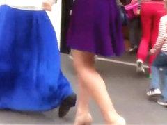 Upskirt look under milf's purple skirt
