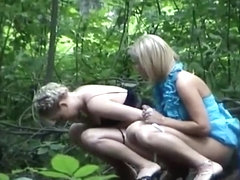 Hot women watering the park plants