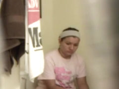 Small secret cam films cute brunette going pee