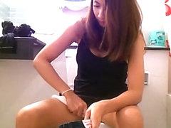 Sexy hot brunette spied in bathroom peeing